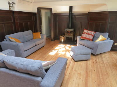 The living space with sofas and wood-burning stove